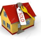12454836-key-with-tag-saying-sold-on-small-family-house-stock-photo
